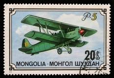 在蒙古打印的邮票显示双翼飞机P-5 免版税图库摄影