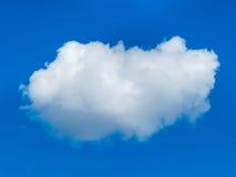 在蓝天的一朵白色云彩 免版税库存图片