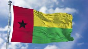 在蓝天的几内亚Biisau旗子 免版税库存图片