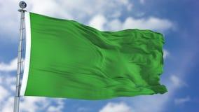 在蓝天的利比亚旗子 库存照片