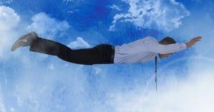 在蓝天的商人飞行 库存图片