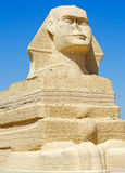 在蓝天的埃及狮身人面象雕象 库存图片