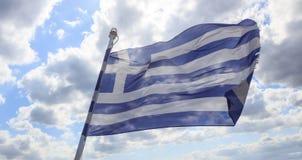 在蓝天的希腊挥动的旗子 免版税库存照片