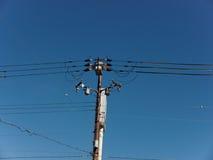在蓝天的电杆 免版税图库摄影