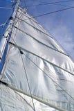 在蓝天的白色风帆 免版税图库摄影