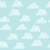 在蓝天的装饰品白色云彩 无缝的模式 图库摄影
