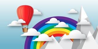 在蓝天的Origami五颜六色的热空气气球与云彩、山峰和彩虹 图库摄影