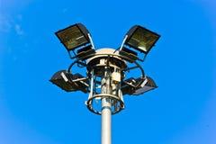 在蓝天背景的灯柱 免版税库存照片