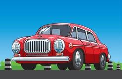 在蓝天背景的红色葡萄酒汽车 免版税库存图片