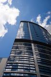 在蓝天背景的高大厦  库存图片