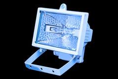 在蓝色光的卤素聚光灯 免版税库存图片