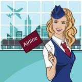 在蓝色制服打扮的迷人的空中小姐 免版税图库摄影
