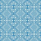 在蓝色和白色颜色的几何无缝的种族样式背景 免版税图库摄影