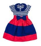 在蓝色和红色条纹的明亮的婴孩礼服 图库摄影