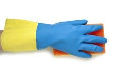 在蓝色和黄色手套的手 免版税库存图片