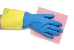 在蓝色和黄色手套的手 库存图片