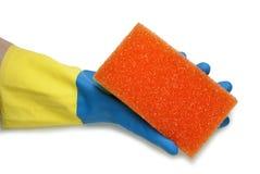 在蓝色和黄色手套的手 图库摄影
