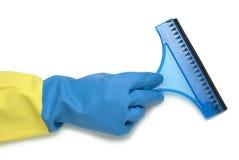 在蓝色和黄色手套的手 库存照片