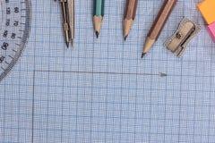 在蓝色图表上的测量的工具 免版税图库摄影