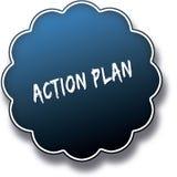 在蓝色圆的标签徽章写的行动纲领文本 免版税图库摄影
