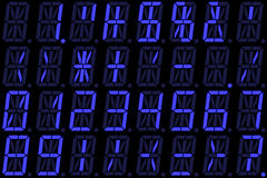 在蓝色字母数字的LED显示的数字式数字 库存图片