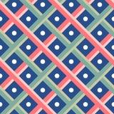 在蓝色小点无缝的样式背景的绿色和红色织法 免版税库存照片