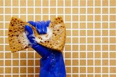 在蓝色手套的手 图库摄影