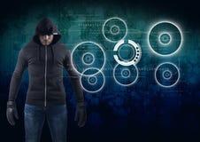在蓝色数字式背景前面的黑客 免版税图库摄影