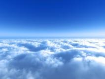 在蓝色明亮的云彩天空之上 库存图片