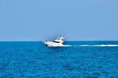在蓝色海运的小船 免版税图库摄影