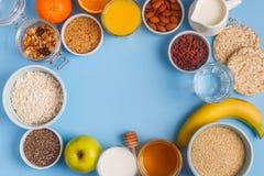 在蓝色淡色背景的有用的早餐 免版税库存图片