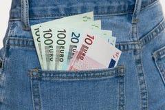 在蓝色牛仔裤口袋的欧洲钞票 免版税图库摄影