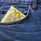 在蓝色牛仔裤的零用钱 库存图片