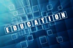 在蓝色玻璃多维数据集的教育 免版税图库摄影