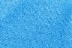在蓝色的亚麻布 织品背景纹理 纺织材料特写镜头细节  库存照片