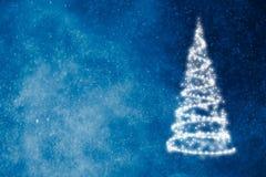 在蓝色的抽象圣诞树 免版税库存照片