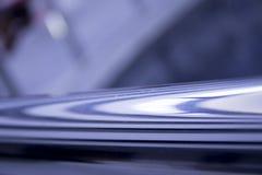 在蓝色的抽象背景与线 免版税图库摄影