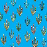 在蓝色的无缝的马赛克仙人掌样式 库存照片
