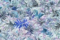 在蓝色的明亮的热带叶子样式 免版税库存照片