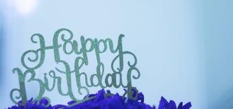 在蓝色的生日快乐 免版税库存照片