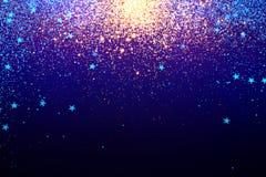 在蓝色的金落的闪闪发光 库存图片