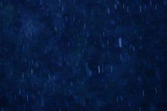 在蓝色的雨 免版税库存图片