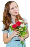 在蓝色礼服的美好的teengirl有花花束的  免版税库存照片
