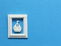 在蓝色背景的一条小船 免版税图库摄影