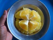 在蓝色背景的切的菠萝 免版税图库摄影