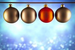 在蓝色背景的四个圣诞节中看不中用的物品 免版税库存图片