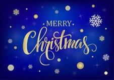 在蓝色背景的圣诞快乐金子 库存照片