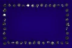 在蓝色背景的金刚石 库存图片