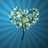 在蓝色背景的心形的树 免版税库存照片