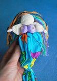 在蓝色背景的手工制造美人鱼玩偶 免版税库存照片
